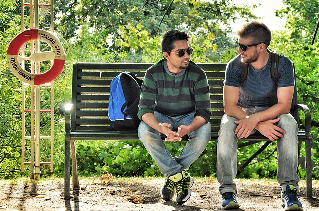 Two men talking on a park bench